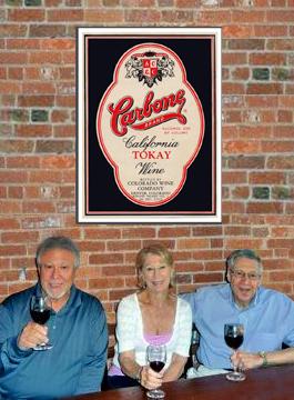 Carbones in front of wine poster